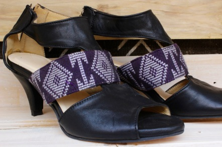 black leather heels with purple pagne on middle band