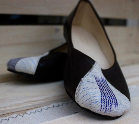 black leather ballet flats with white-blue pagne on toe in tear-drop shape