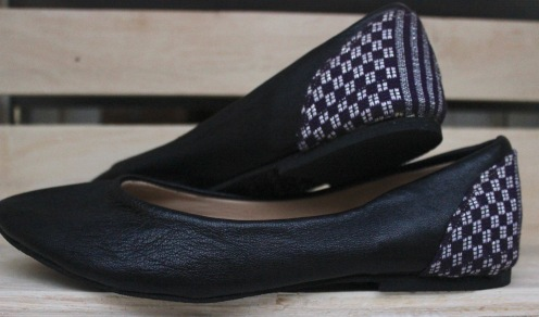 black ballet flats with purple pagne on back