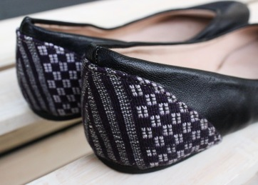 black ballet flats with purple pagne on heel